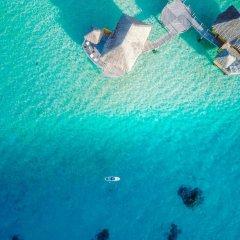 Отель Le Taha'a Island Resort & Spa пляж