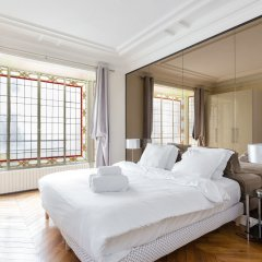 Апартаменты Arc de Triomphe Champs Elysees Apartment комната для гостей фото 3
