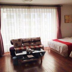Free Town Apartment Hotel Пекин комната для гостей фото 2