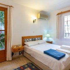 Korsan Apartments Турция, Калкан - отзывы, цены и фото номеров - забронировать отель Korsan Apartments онлайн комната для гостей фото 2