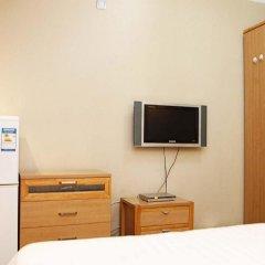 Отель Holiday Hotel Apartment Китай, Шэньчжэнь - отзывы, цены и фото номеров - забронировать отель Holiday Hotel Apartment онлайн удобства в номере