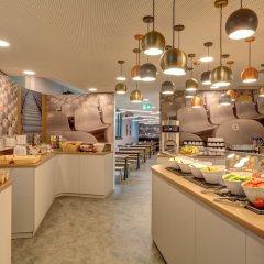 Отель MEININGER Hotel Munich Olympiapark Германия, Мюнхен - отзывы, цены и фото номеров - забронировать отель MEININGER Hotel Munich Olympiapark онлайн питание фото 2