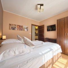 Апартаменты SKY Apartments VisitZakopane сейф в номере
