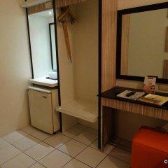 Отель Octagon Mansion Hotel Филиппины, Манила - отзывы, цены и фото номеров - забронировать отель Octagon Mansion Hotel онлайн удобства в номере фото 2