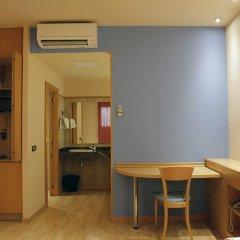Отель Apartamentos DV Испания, Барселона - отзывы, цены и фото номеров - забронировать отель Apartamentos DV онлайн удобства в номере фото 2