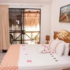 Отель Villas Mercedes Сиуатанехо комната для гостей фото 4