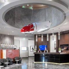 Отель Dorint Airport-Hotel Zürich Швейцария, Глаттбруг - отзывы, цены и фото номеров - забронировать отель Dorint Airport-Hotel Zürich онлайн интерьер отеля