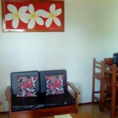 Апартаменты Al-Minhaj Service Apartments комната для гостей фото 5