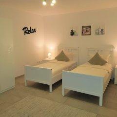 Апартаменты Dibeka Apartments Köln Messe Кёльн комната для гостей фото 5