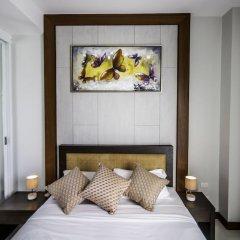 Отель Q Residence пляж Ката комната для гостей