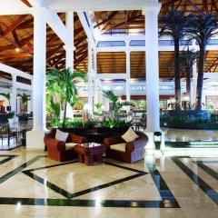 Отель Grand Bahia Principe Punta Cana - All Inclusive Доминикана, Пунта Кана - отзывы, цены и фото номеров - забронировать отель Grand Bahia Principe Punta Cana - All Inclusive онлайн интерьер отеля