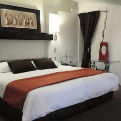 Aztic Hotel & Suites Ejecutivas комната для гостей фото 4