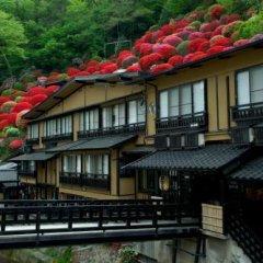 Отель Kurokawa Onsen Yama No Yado Shinmeikan Минамиогуни балкон