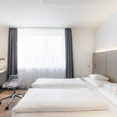 Отель BURNS fair & more сейф в номере