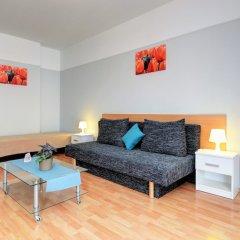 Апартаменты Agape Apartments комната для гостей фото 17