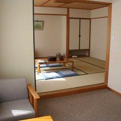 Отель Kyukamura Minami-Aso National Park Resort Villages Of Japan Минамиогуни комната для гостей