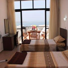 Отель Seashells Penthouse Буджибба комната для гостей фото 4