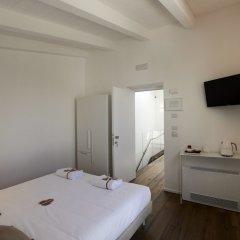 Отель Iulius Suite & spa Конверсано в номере