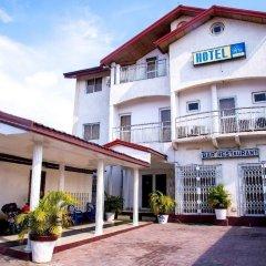 Отель Résidence Hôtelière de Moungali Республика Конго, Браззавиль - отзывы, цены и фото номеров - забронировать отель Résidence Hôtelière de Moungali онлайн вид на фасад