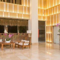Отель Impressive Premium Resort & Spa Punta Cana – All Inclusive Доминикана, Пунта Кана - отзывы, цены и фото номеров - забронировать отель Impressive Premium Resort & Spa Punta Cana – All Inclusive онлайн интерьер отеля фото 2