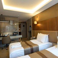 Отель GK Regency Suites комната для гостей фото 5