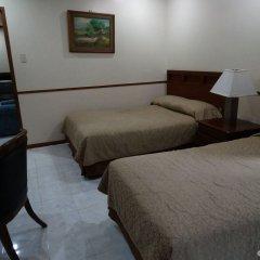 Отель Garden Plaza Hotel Филиппины, Манила - отзывы, цены и фото номеров - забронировать отель Garden Plaza Hotel онлайн комната для гостей фото 3