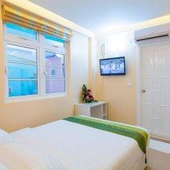 Отель City Grand Мале комната для гостей фото 2