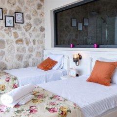 Villa Sur by Akdenizvillam Турция, Калкан - отзывы, цены и фото номеров - забронировать отель Villa Sur by Akdenizvillam онлайн комната для гостей фото 3