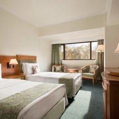 Отель Рамада Ташкент комната для гостей фото 3