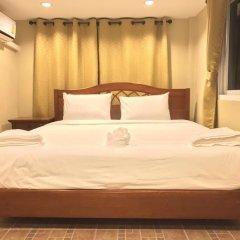 Апартаменты AN Apartment Паттайя комната для гостей фото 2
