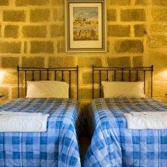 Отель Gozo Farmhouses - Gozo Village Holidays Мальта, Виктория - отзывы, цены и фото номеров - забронировать отель Gozo Farmhouses - Gozo Village Holidays онлайн комната для гостей фото 3