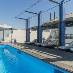 Отель AC Hotel Ciudad de Sevilla by Marriott Испания, Севилья - отзывы, цены и фото номеров - забронировать отель AC Hotel Ciudad de Sevilla by Marriott онлайн бассейн фото 3