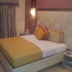 Отель Calabar Harbour Resort SPA Нигерия, Калабар - отзывы, цены и фото номеров - забронировать отель Calabar Harbour Resort SPA онлайн комната для гостей фото 4