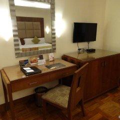 Отель City Garden Suites Manila Филиппины, Манила - 1 отзыв об отеле, цены и фото номеров - забронировать отель City Garden Suites Manila онлайн удобства в номере
