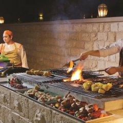 Traders Hotel Qaryat Al Beri Abu Dhabi, by Shangri-la питание фото 3