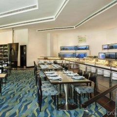 Отель Le Meridien Dubai Hotel & Conference Centre ОАЭ, Дубай - отзывы, цены и фото номеров - забронировать отель Le Meridien Dubai Hotel & Conference Centre онлайн питание фото 2