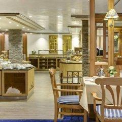 Отель HUUS Gstaad Швейцария, Занен - отзывы, цены и фото номеров - забронировать отель HUUS Gstaad онлайн питание