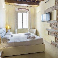 Апартаменты Piccolo Signoria Apartment Флоренция комната для гостей фото 5