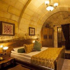 Отель Kayakapi Premium Caves Cappadocia комната для гостей фото 3