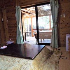 Отель Kurasako Onsen Sakura Япония, Минамиогуни - отзывы, цены и фото номеров - забронировать отель Kurasako Onsen Sakura онлайн комната для гостей фото 2
