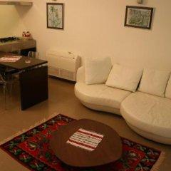 Отель Bougainville Bay Serviced Apartments Албания, Саранда - отзывы, цены и фото номеров - забронировать отель Bougainville Bay Serviced Apartments онлайн удобства в номере