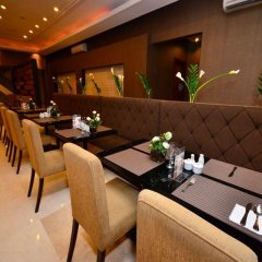 Отель City Garden Suites Manila Филиппины, Манила - 1 отзыв об отеле, цены и фото номеров - забронировать отель City Garden Suites Manila онлайн питание фото 3