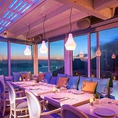 Отель Mill Houses Elegant Suites Греция, Остров Санторини - отзывы, цены и фото номеров - забронировать отель Mill Houses Elegant Suites онлайн питание