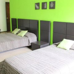 Отель Hostal Amigo Suites Мехико сейф в номере
