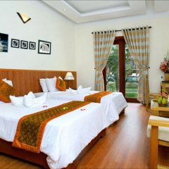 Отель Green Field Villas Хойан комната для гостей