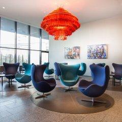 Отель Radisson Blu Hotel Zurich Airport Швейцария, Цюрих - 1 отзыв об отеле, цены и фото номеров - забронировать отель Radisson Blu Hotel Zurich Airport онлайн интерьер отеля фото 3