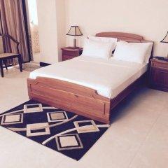 Отель Crescatcity Apartments Шри-Ланка, Коломбо - отзывы, цены и фото номеров - забронировать отель Crescatcity Apartments онлайн комната для гостей фото 2
