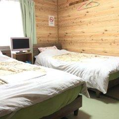Отель Minshuku Kaisei 1 Якусима сейф в номере