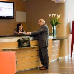 Отель Novotel Bologna Fiera Италия, Болонья - отзывы, цены и фото номеров - забронировать отель Novotel Bologna Fiera онлайн интерьер отеля фото 2