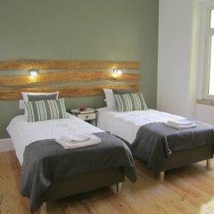 Отель Castilho Lisbon Suites Лиссабон комната для гостей